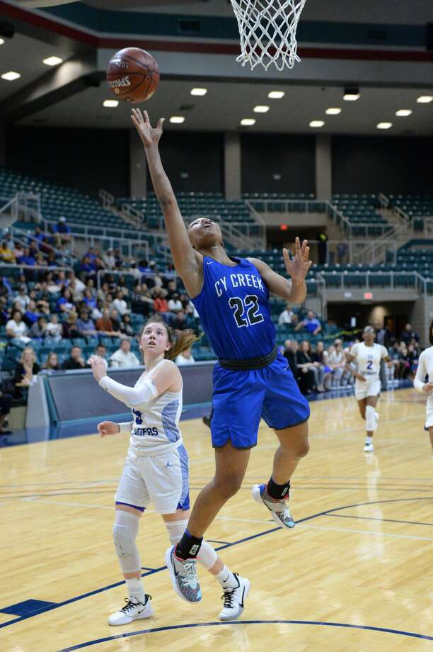 Kyndall Hunter (22) of Cy Creek drives to the basket during the fourth quarter of a Girls Region III-6A championship between the Cy Creek Cougars and the Clear Springs Chargers on Saturday, February 29, 2020 at the Leonard Merrell Center, Katy, TX. Photo: Craig Moseley/Staff Photographer