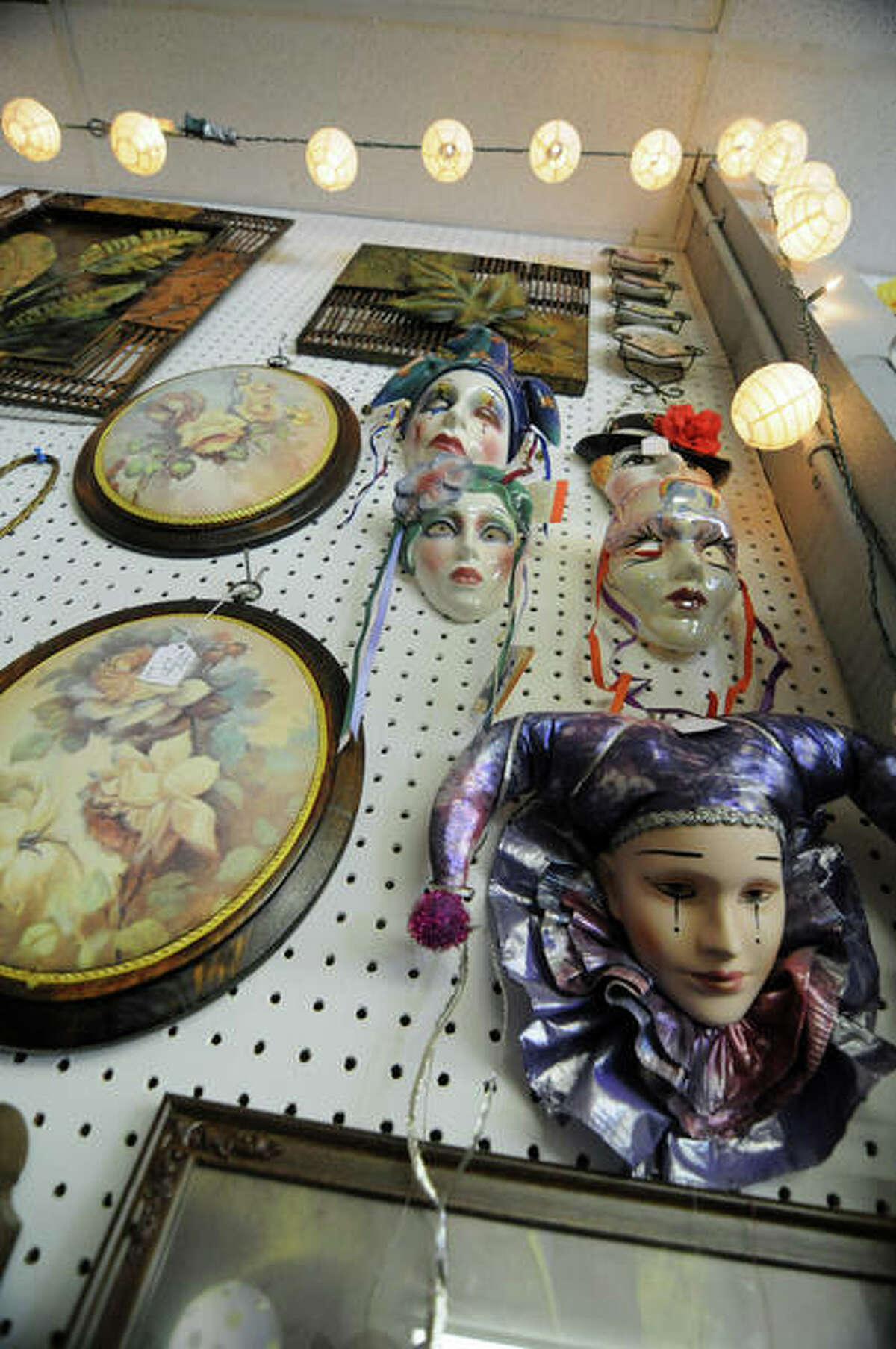 Decorative theatrical masks, folk paintings and more are among the many items for sale at The Hangar Emporium. The new East Alton business held a grand opening Saturday.