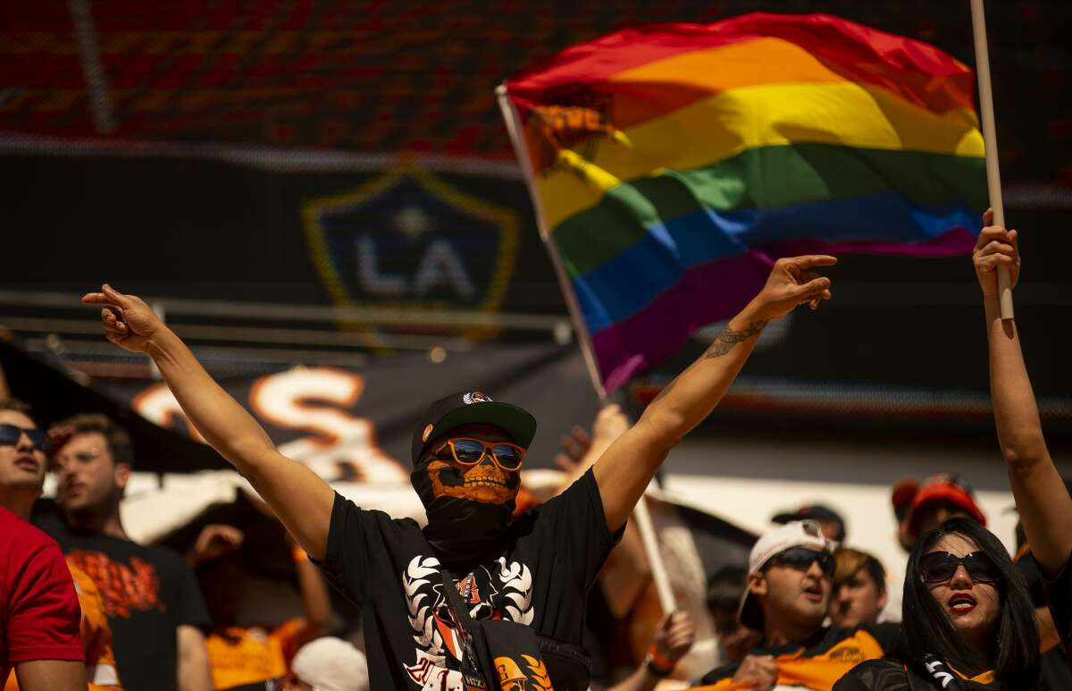 Dynamo supporters cheer before a match between the Houston Dynamo and LA Galaxy, Saturday, Feb. 29, 2020, at BBVA Stadium in Houston.