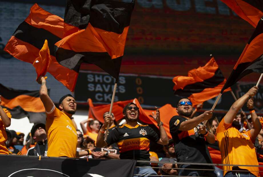 Dynamo supporters cheer before a match between the Houston Dynamo and LA Galaxy, Saturday, Feb. 29, 2020, at BBVA Stadium in Houston. Photo: Mark Mulligan/Staff Photographer