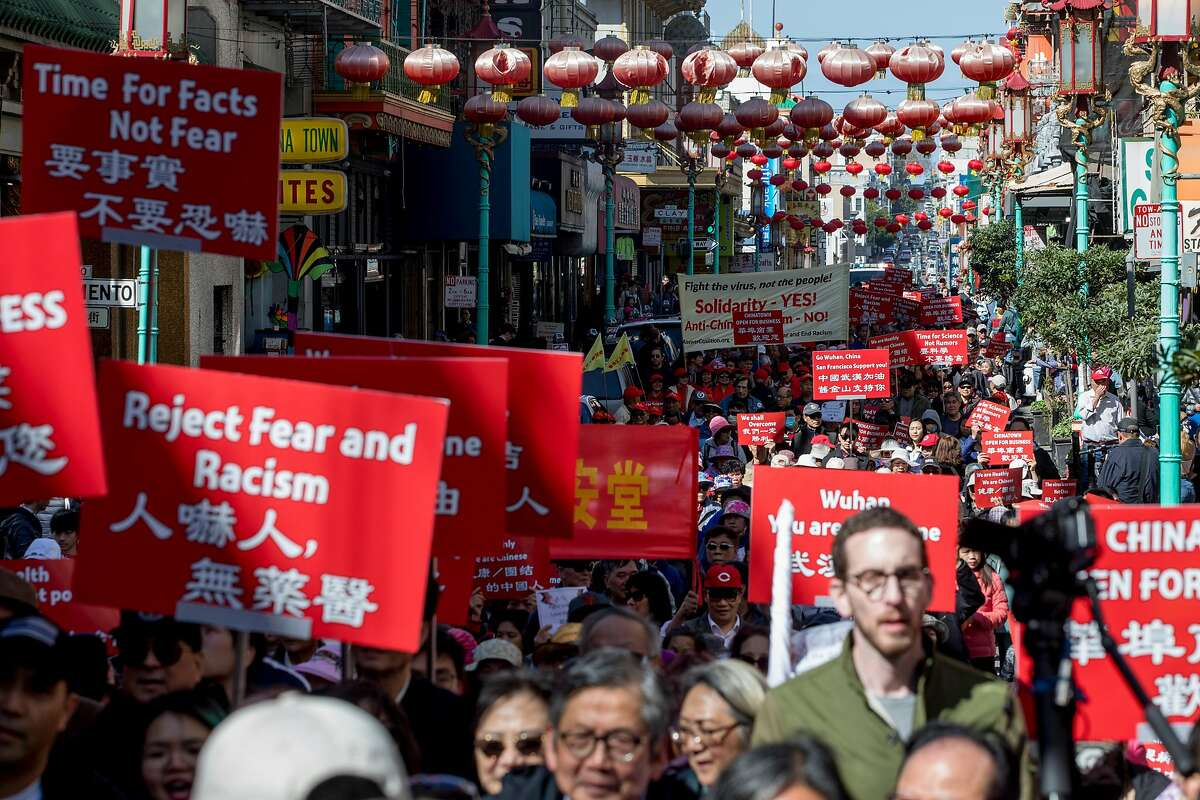 Hundreds take to the streets protest against racism in the Chinese community during a march down Grant Avenue from Chinatown's Portsmouth Square to Union Square in San Francisco, Calif. Saturday, February 29, 2020. Racism against the Chinese community has increased since the discovery of the first Coronavirus outbreak in Wuhan, China has spread globally.