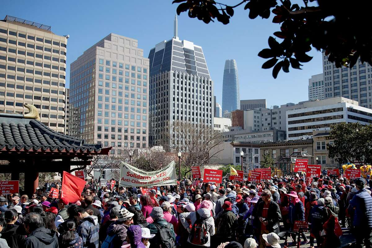 Hundreds of demonstrators carry signs and gather to protest against racism in the Chinese community during a rally held at Portsmouth Square in the Chinatown neighborhood of San Francisco, Calif. Saturday, February 29, 2020. Racism against the Chinese community has increased since the discovery of the first Coronavirus outbreak in Wuhan, China has spread globally.