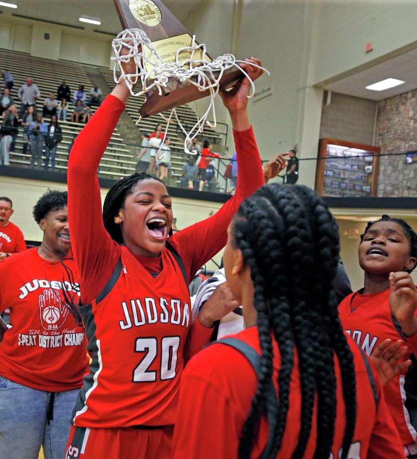 Judson guard Kierra Sanderlin #20 holds up their trophy after they defeated Austin Westlake 50-47 in Region IV-6A championship on Saturday, Feb. 29, 2020 at Littleton Gym. Photo: Ronald Cortes/Contributor / 2020 Ronald Cortes