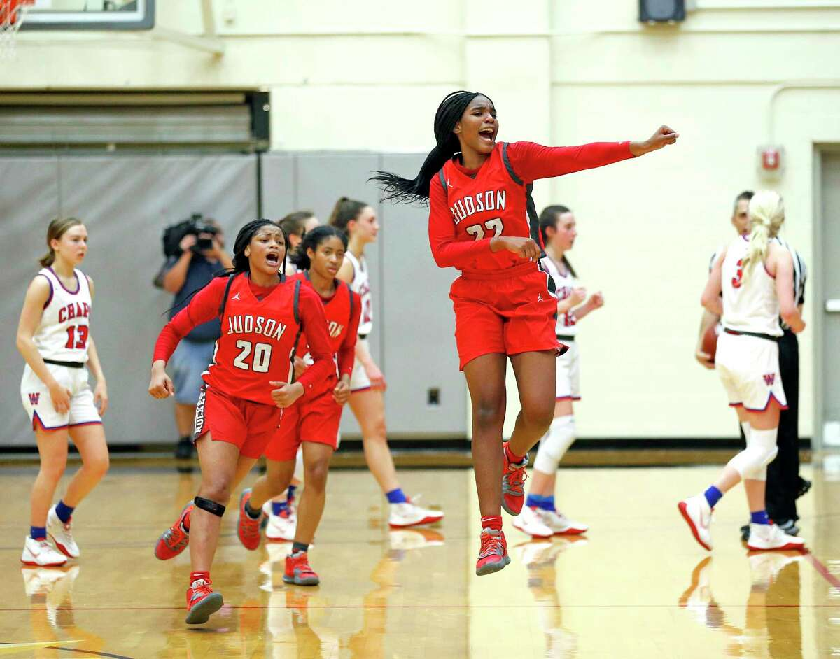 Judson forward Amira Mabry #22 and Judson guard Kierra Sanderlin #20 celebrates after they gained possession of the ball in closing seconds of the second half. Judson defeated Austin Westlake 50-47 in Region IV-6A championship on Saturday, Feb. 29, 2020 at Littleton Gym.