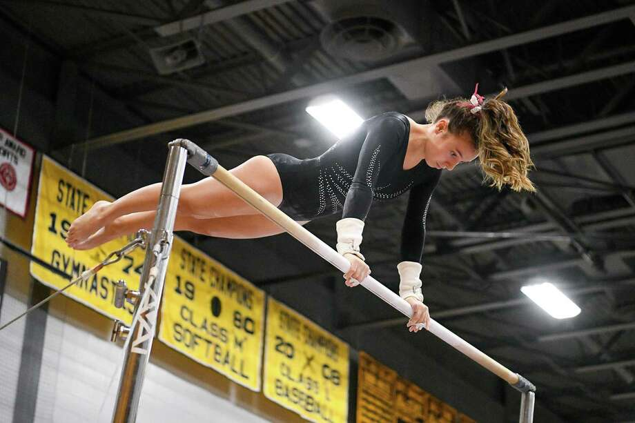 Farmington's Gabrielle Butler competes in the Uneven Bars during the CIAC Class M Gymnastics Championship at Jonathan Law, Saturday, February 29, 2020, Photo: David G Whitham / Copyriqht 2020 David G. Whitham, All rights reserved.