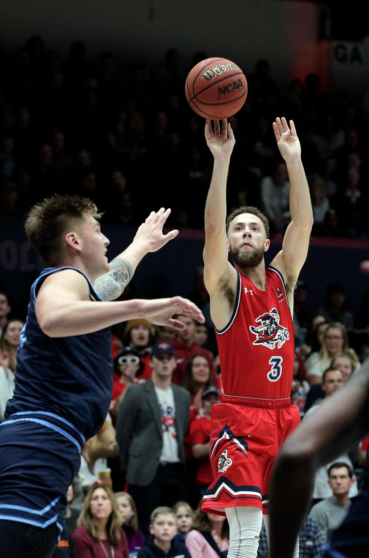 Jordan Ford (3) shoots over Alex Floresca (15) In the first half as the St. Mary's Gaels played the University of San Diego Toreros at McKeon Pavilion in the Gael's final home game in Moraga, Calif., on Saturday, February 22, 2020.
