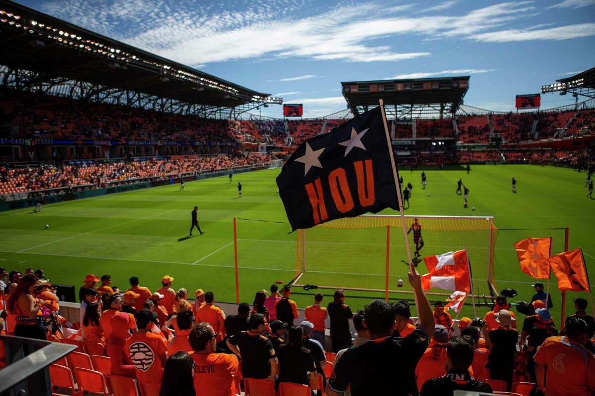 Supporters cheer before a match between the Houston Dynamo and LA Galaxy, Saturday, Feb. 29, 2020, at BBVA Stadium in Houston.