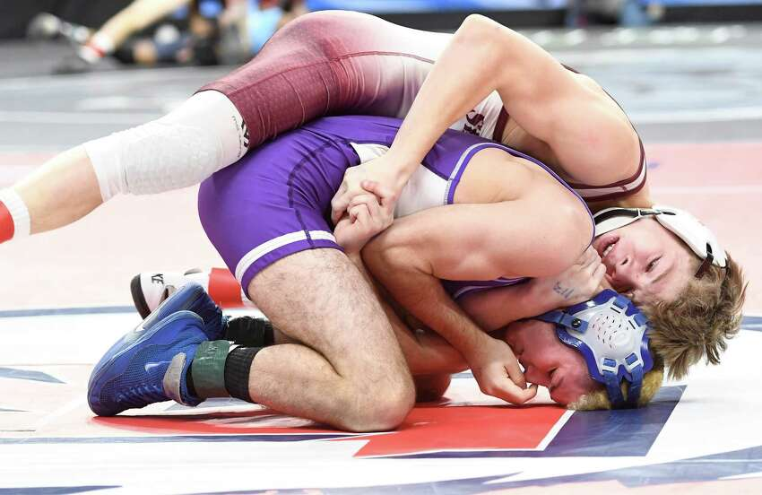 Shen's Stevo Poulin holds Webster-Schroder's Anthony Surace in a 113-lb. weight class semifinal match at the Times Union Center in Albany on Saturday, Feb. 29, 2020. (Jenn March, Special to the Times Union)