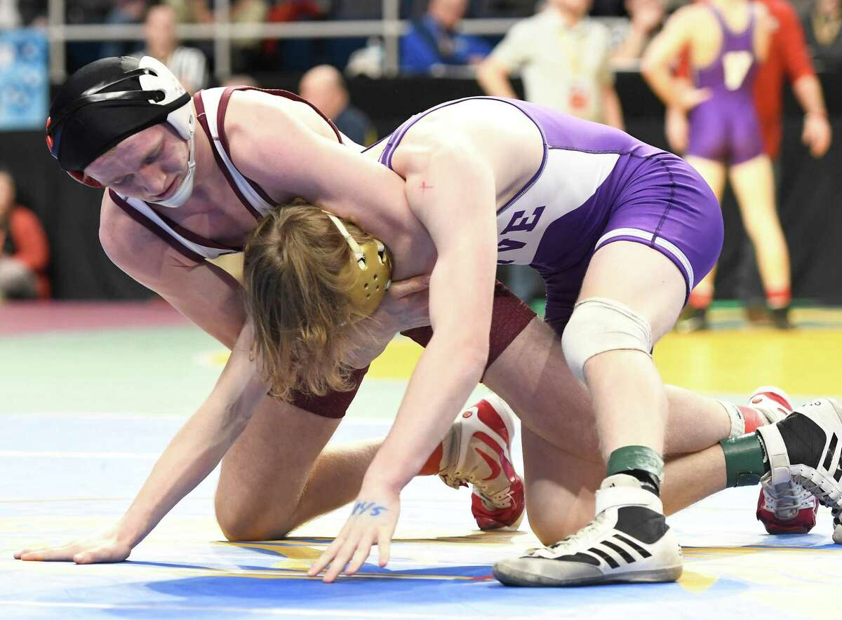 Tamarac's Bobby Treshock holds East Rochester's Seamus Castello in a headlock during a 145-lb. weight class State Semifinal match at the Times Union Center in Albany on Saturday, Feb. 29, 2020. (Jenn March, Special to the Times Union)