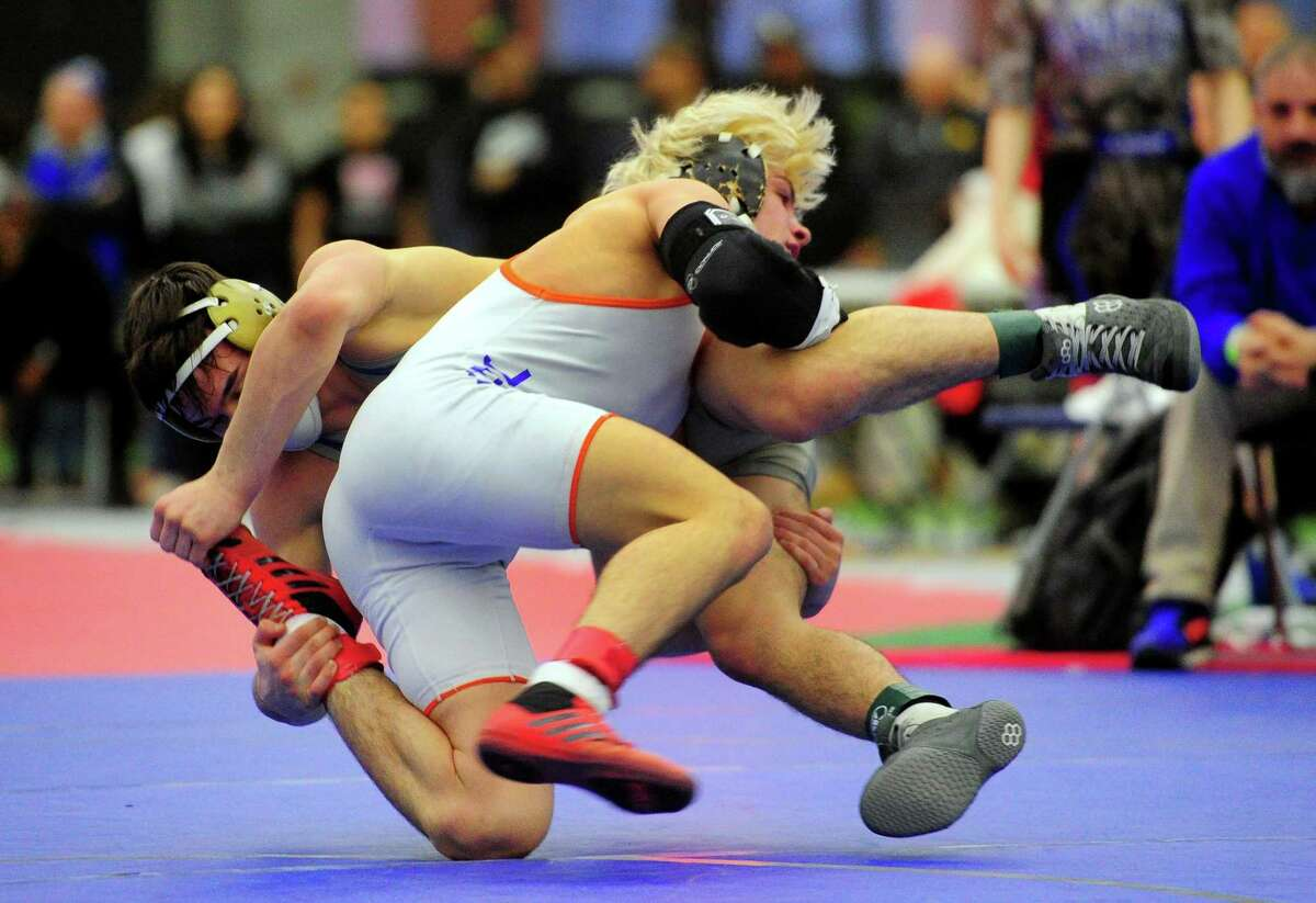 Danbury's Ryan Jack wrestles against Bristol Eastern's Thomas Nichols during CIAC State Open in New Haven on Saturday. Danbury won its fourth consecutive title.