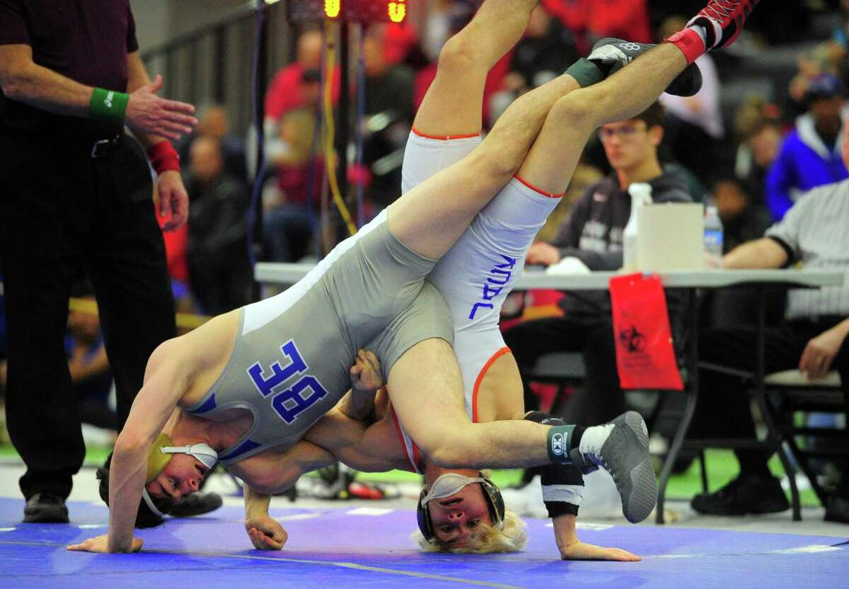 Bristol Eastern's Thomas Nichols, left, gets tangled up with Danbury's Ryan Jack during CIAC state open championship wrestling action in New Haven, Conn., on Saturday Feb. 29, 2020.
