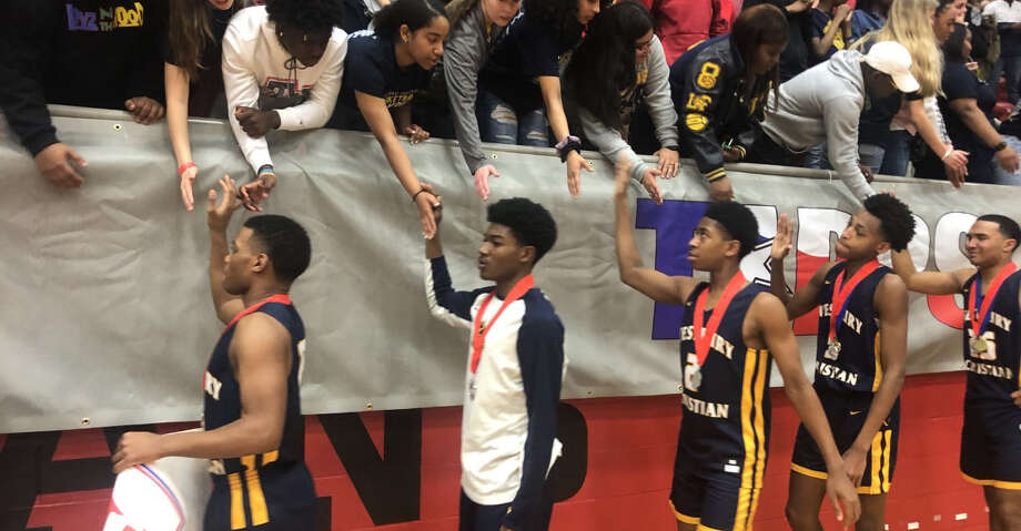 Westbury Christian basketball players are congratulated by supporters after the TAPPS 5A state championship game against Frisco Legacy Christian. Photo: Josh Criswell/Huntsville Item