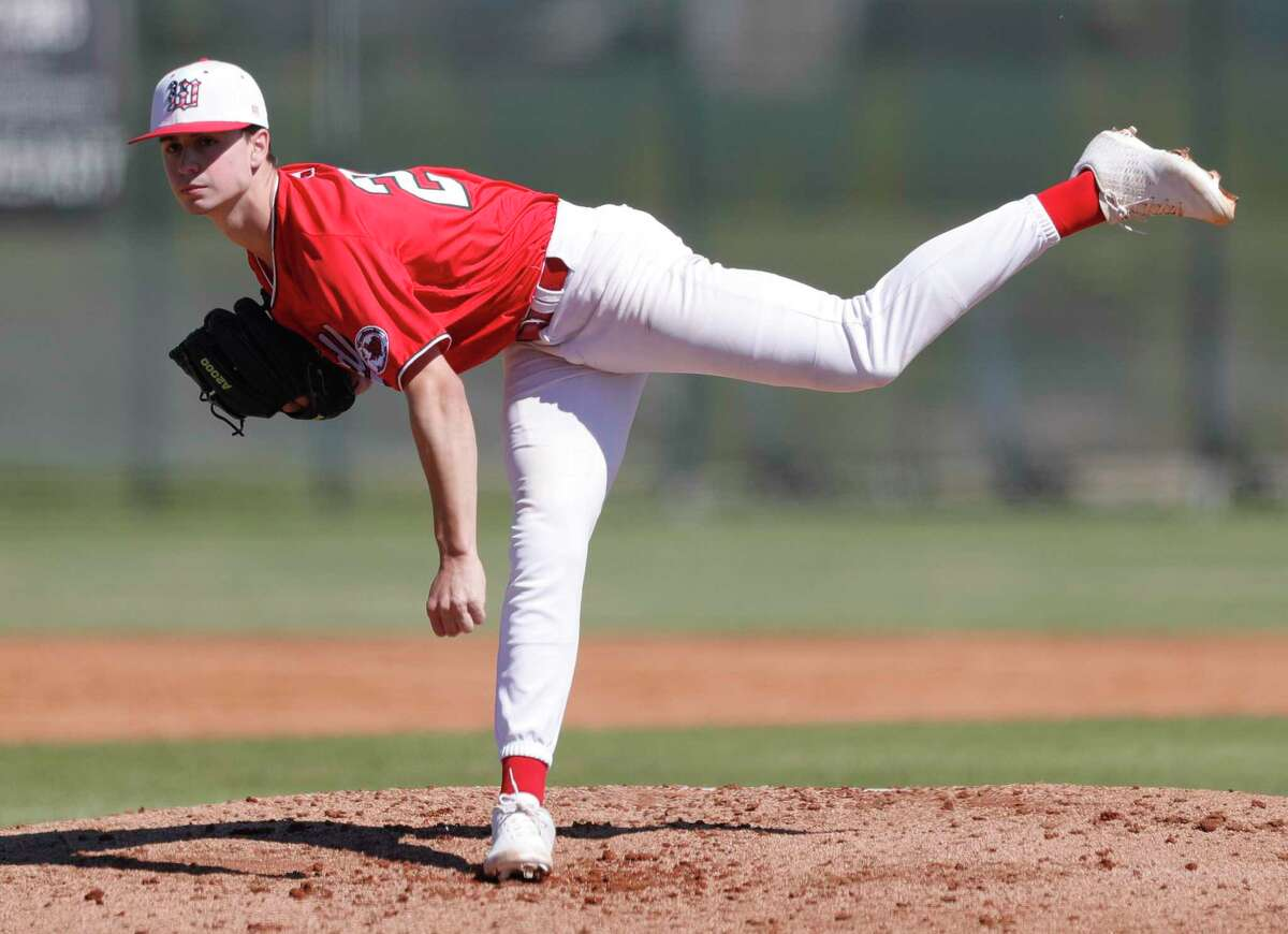 The Woodlands starting pitcher Cameron Caley (20) throws during a non-district high school baseball game at Kingwood Park High School, Thursday, Feb. 27, 2020, in Kingwood. The Woodlands defeated Kingwood Park 10-0.