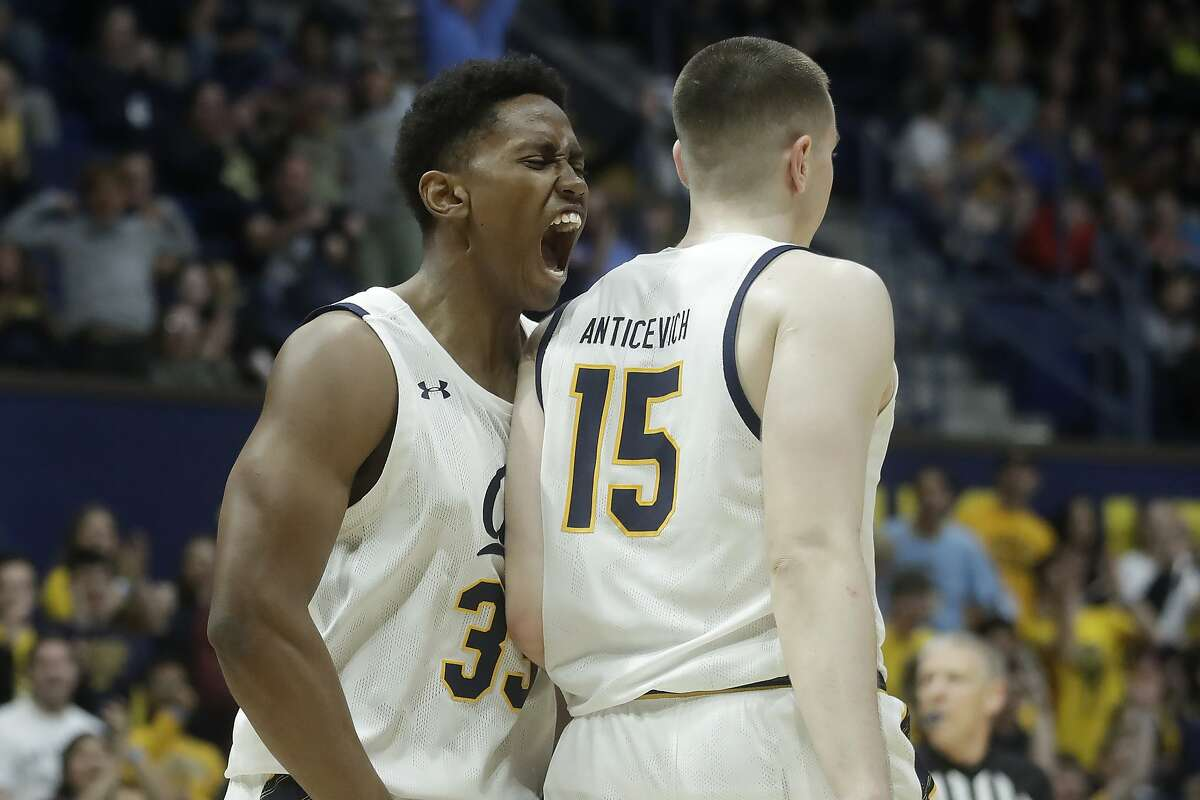 California forward Grant Anticevich (15) is congratulated by forward D.J. Thorpe after scoring against Utah during the second half of an NCAA college basketball game in Berkeley, Calif., Saturday, Feb. 29, 2020. California won 86-79 in overtime. (AP Photo/Jeff Chiu)