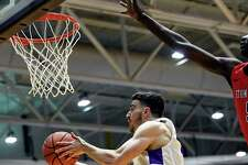 University at Albany guard JoJo Anderson (3) scores against Stony Brook during the first half of a NCAA college basketball game, Saturday, Feb. 29, 2020, in Albany, N.Y.