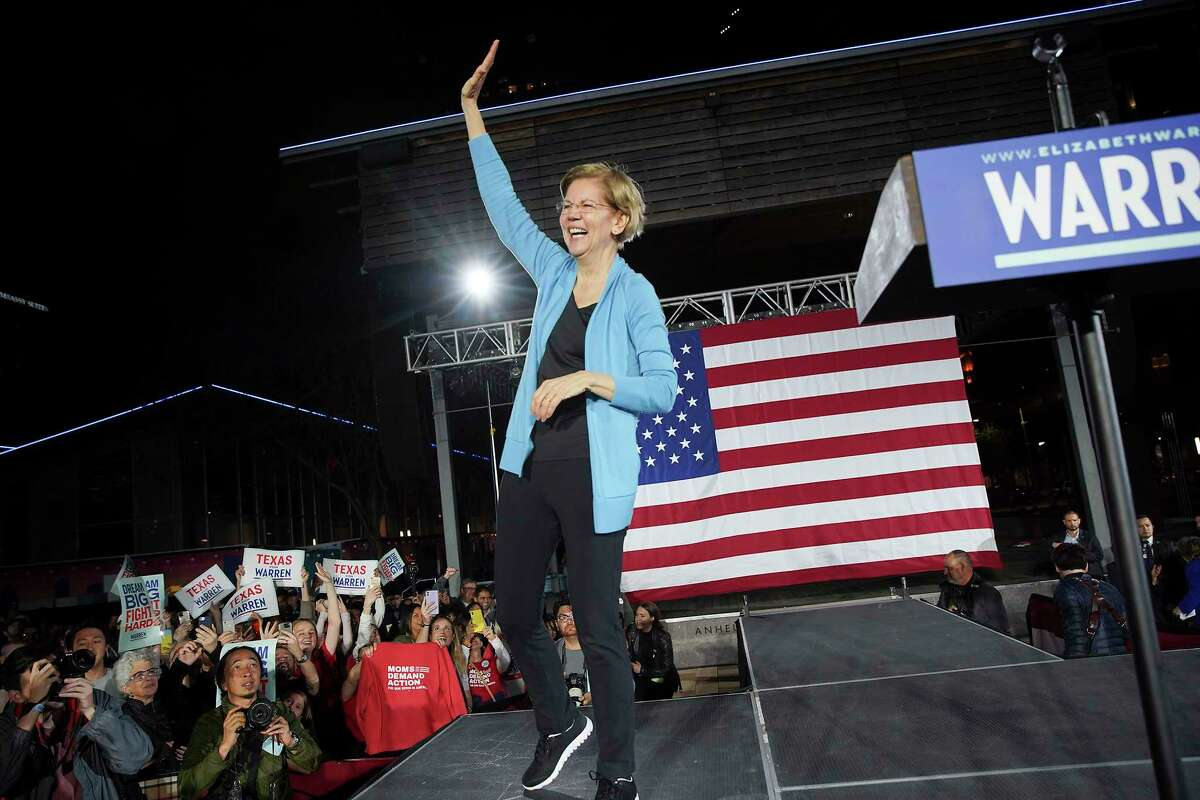 U.S. Democratic presidential candidate Elizabeth Warren laughs after giving a speech during a town hall gathering a Discovery Green in downtown Houston on Saturday, February 29, 2020.