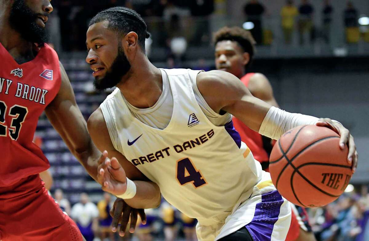 University at Albany guard Ahmad Clark (4) moves the ball against the Stony Brook during the first half of a NCAA college basketball game, Saturday, Feb. 29, 2020, in Albany, N.Y. (Hans Pennink / Special to the Times Union)
