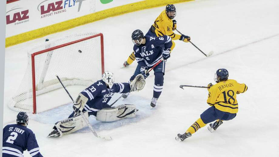 Former Quinnipiac captain Nick Jermain, right, of Norwalk has signed with the ECHL's Greenville Swamp. Photo: Steve Musco / Contributed Photo / © Steve Musco 2019-2020, all rights reserved