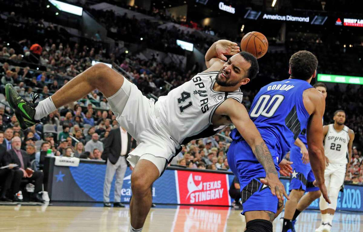 Trey Lyles #41 of the San Antonio Spurs gets and one after being found by Aaron Gordon #00 of the Orlando Magic in the second half on Saturday, February 29, 2020 at AT&T Center