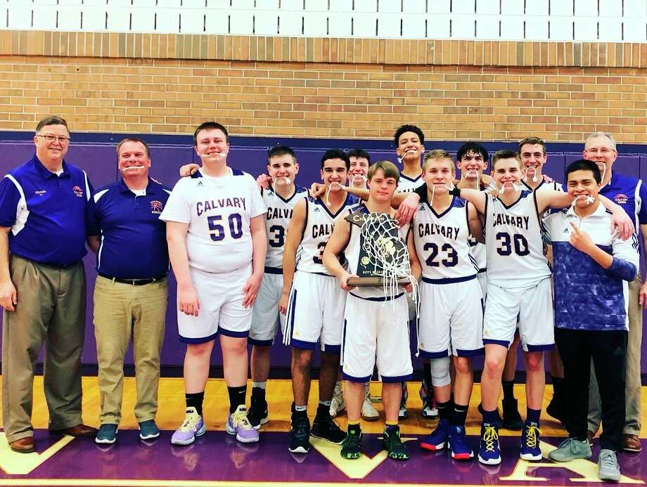 Pictured are (front row, from left) head coach John VanHolstyn, coach Jason Warner, Caleb Hughes, Charley Tomko, Jordan Altenburg, Brendan Warren, Ian Theaker, Alex Kunselman; (back row, from left) Seth Theaker, Nate Wiggins, Evan Figueroa, Josh Kipfmiller, Toby Stauffer and coach Kyle Theaker. Not pictured is Jude Tenbusch.