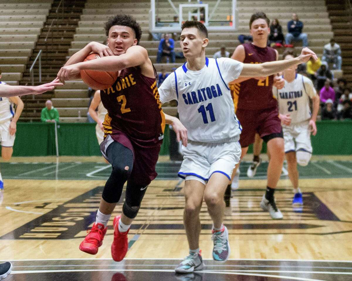 Colonie junior Ashon Wright drives by Saratoga senior Aidan Dagostino during the Section II, Class AA quarterfinals at Hudson Valley Community College in Troy, NY on Saturday, Feb. 29, 2020 (Jim Franco/Special to the Times Union.)