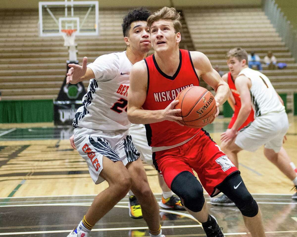 Niskayuna senior Sean St. Lucia drives to the basket in front of Bethlehem senior Kendrick McCann during the Section II, Class AA quarterfinals at Hudson Valley Community College in Troy, NY on Saturday, Feb. 29, 2020 (Jim Franco/Special to the Times Union.)
