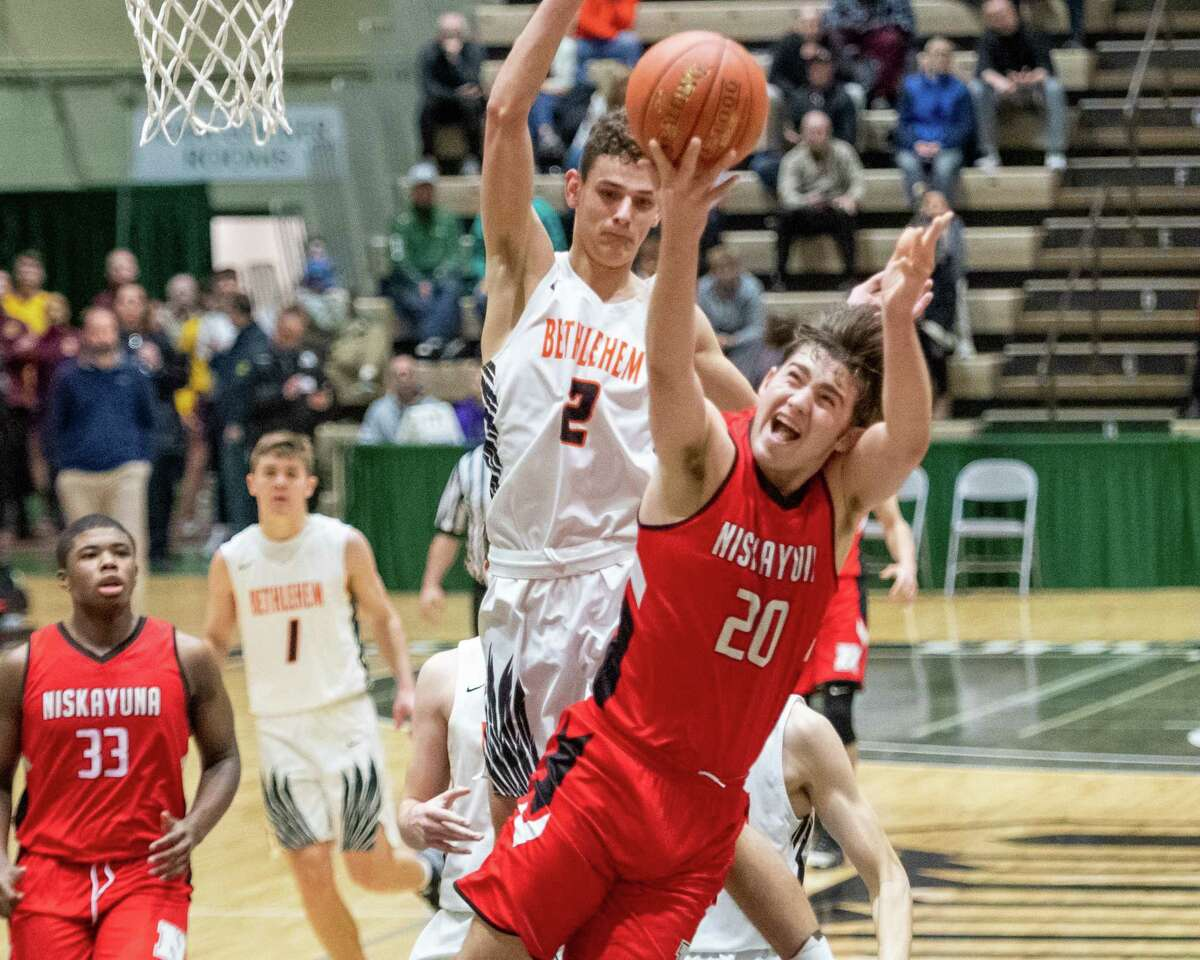 Niskayuna sophomore Gabe Eldaye grabs a rebound in front of Bethlehem senior Zachary Zonca during the Section II, Class AA quarterfinals at Hudson Valley Community College in Troy, NY on Saturday, Feb. 29, 2020 (Jim Franco/Special to the Times Union.)