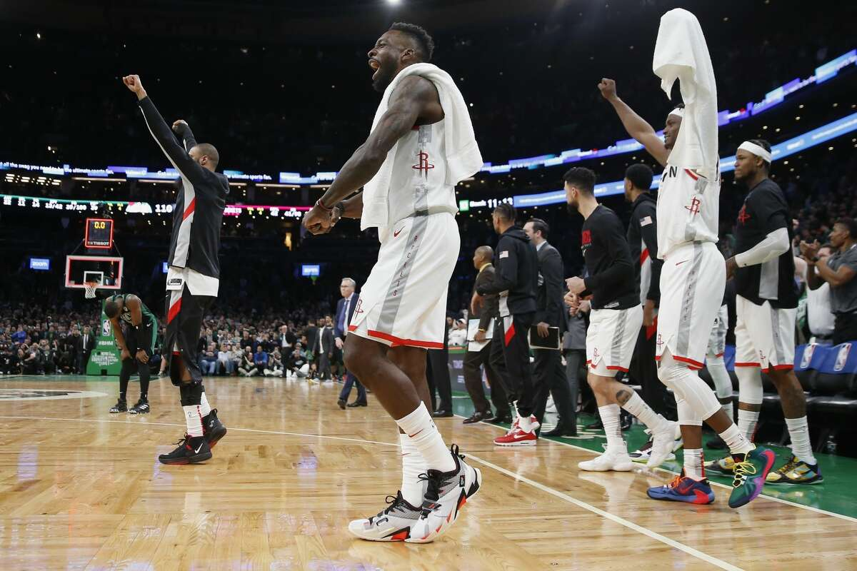 Houston Rockets' Jeff Green, center, and teammates celebrate after defeating the Boston Celtics 111-110 in overtime during an NBA basketball game in Boston, Saturday, Feb. 29, 2020. (AP Photo/Michael Dwyer)