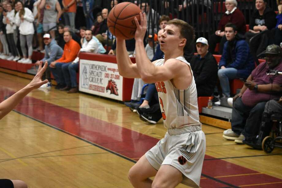 Ridgefield's Johnny Briody takes a shot during the FCIAC quarterfinals at Fairfield Warde on Saturday, Feb. 29, 2020. Photo: Pete Paguaga / Hearst Connecticut Media