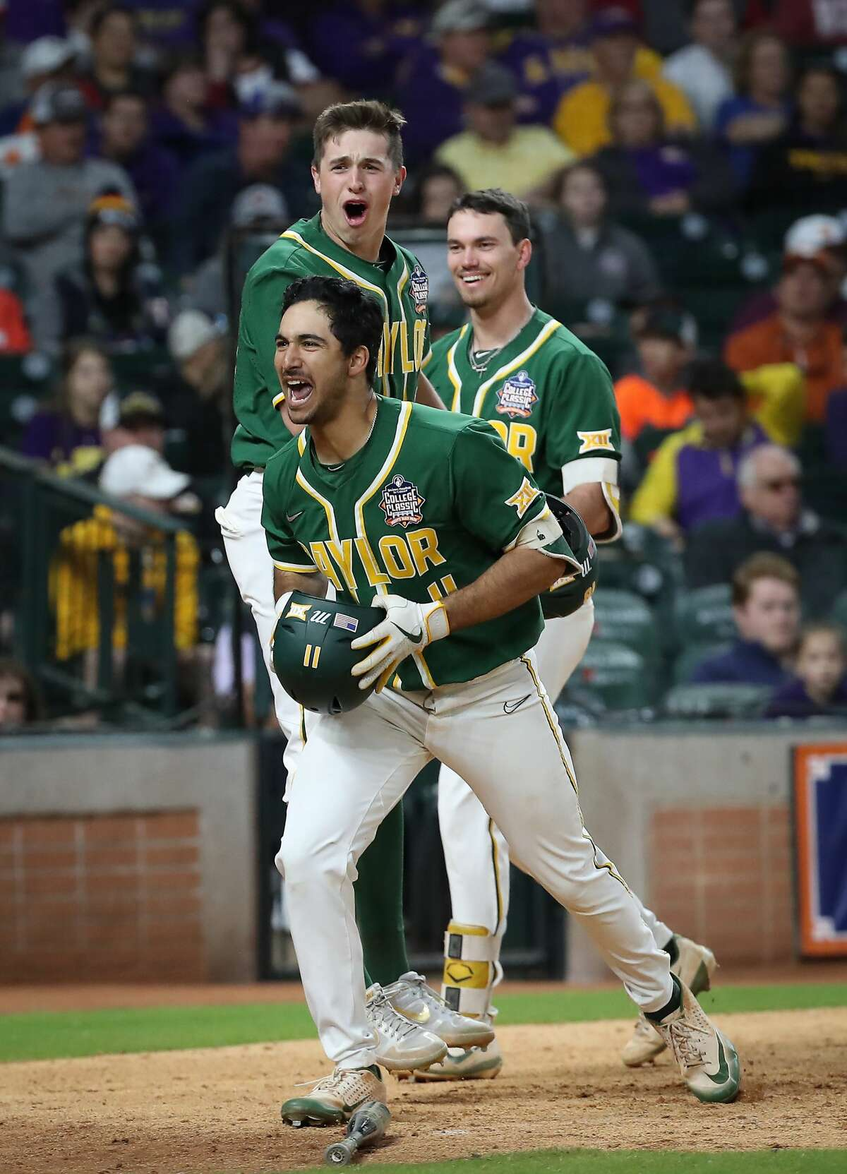 Baylor's Ricky Martinez celebrates after hitting a two-run homer during the 7th inning of the Shriners Hospitals for Children College Classic at Minute Maid Park Saturday, Feb. 29, 2020, in Houston.