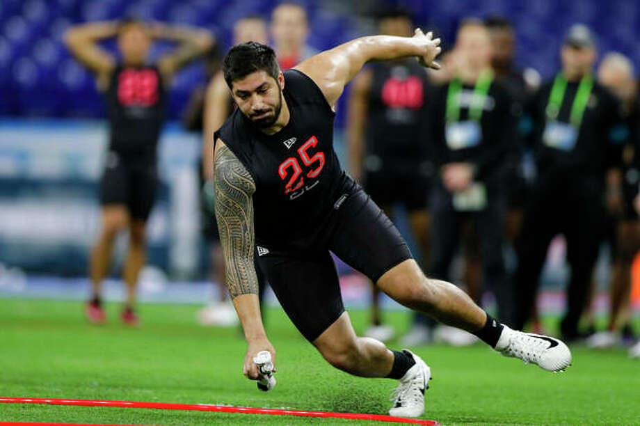 Iowa defensive lineman A.J. Epenesa runs a drill at the NFL football scouting combine in Indianapolis, Saturday, Feb. 29, 2020. Photo: Associated Press