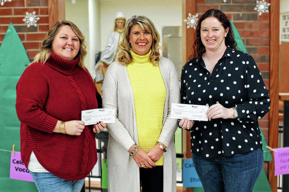 Routt Catholic High School/Our Saviour School Dreams co-chairs Maggie Peterson (left) and Katie Doyle (right) present funds totaling $120,000 to Our Saviour School Principal Stevie VanDeVelde. Of that, $110,000 will go toward the schools' operating expenses, while the additional $10,000 will be reserved for enhancements to the schools' curriculum, technology and professional development. Photo: Photo Provided