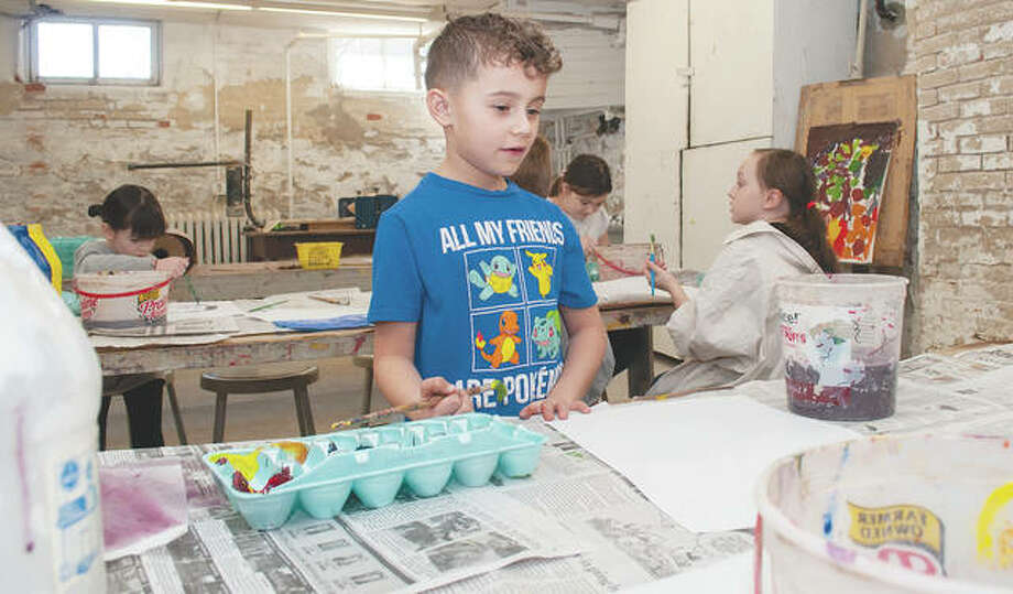 Jenson Tranbarger, 6, contemplates what he's going to paint during a class Saturday. The David Strawn Art Gallery has classes throughout the year for children and adults. Photo: Darren Iozia | Journal-Courier
