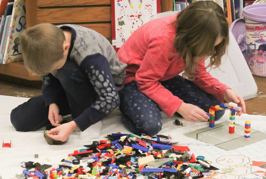 The Bad Axe District Library celebrated Leap Year on Saturday with a special Lego Challenge for kids 5 and older. Photo: Mark Birdsall/Huron Daily Tribune