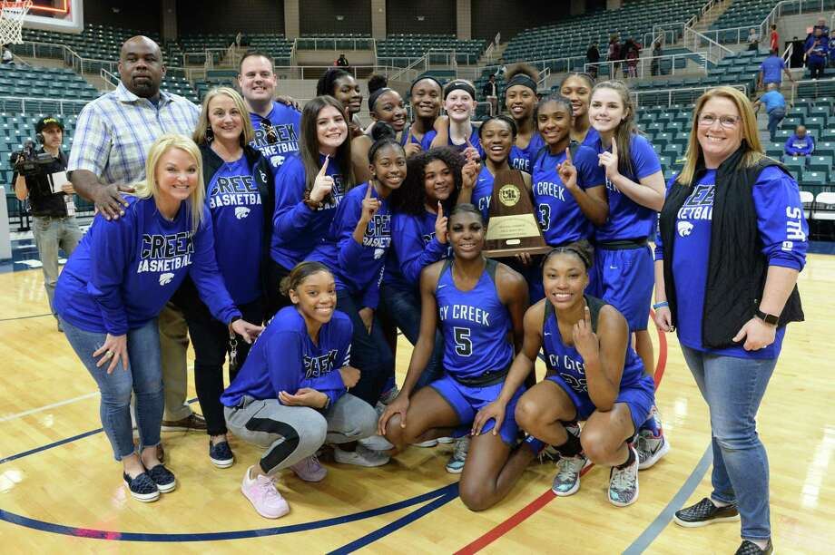 The Cy Creek Cougars celebrate their 60-40 victory over the Clear Springs Chargers in the Girls Region III-6A championship game on Saturday, February 29, 2020 at the Leonard Merrell Center, Katy, TX. Photo: Craig Moseley, Houston Chronicle / Staff Photographer / ©2020 Houston Chronicle