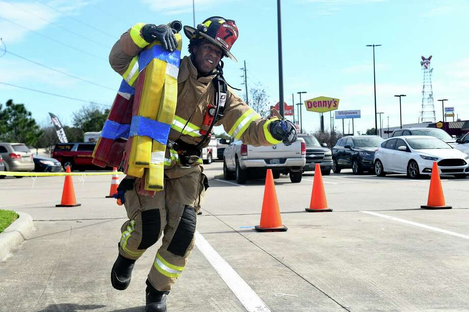 Spring Fire Dept. firefighter Eric Marsh works the hose carry during his team's rotation on the course during the Spring Fire Dept. Firefighter Challenge held in the LA Fitness parking lot at 20121 IH-45 in Spring on Feb. 29, 2020. Photo: Jerry Baker, Houston Chronicle / Contributor / Houston Chronicle
