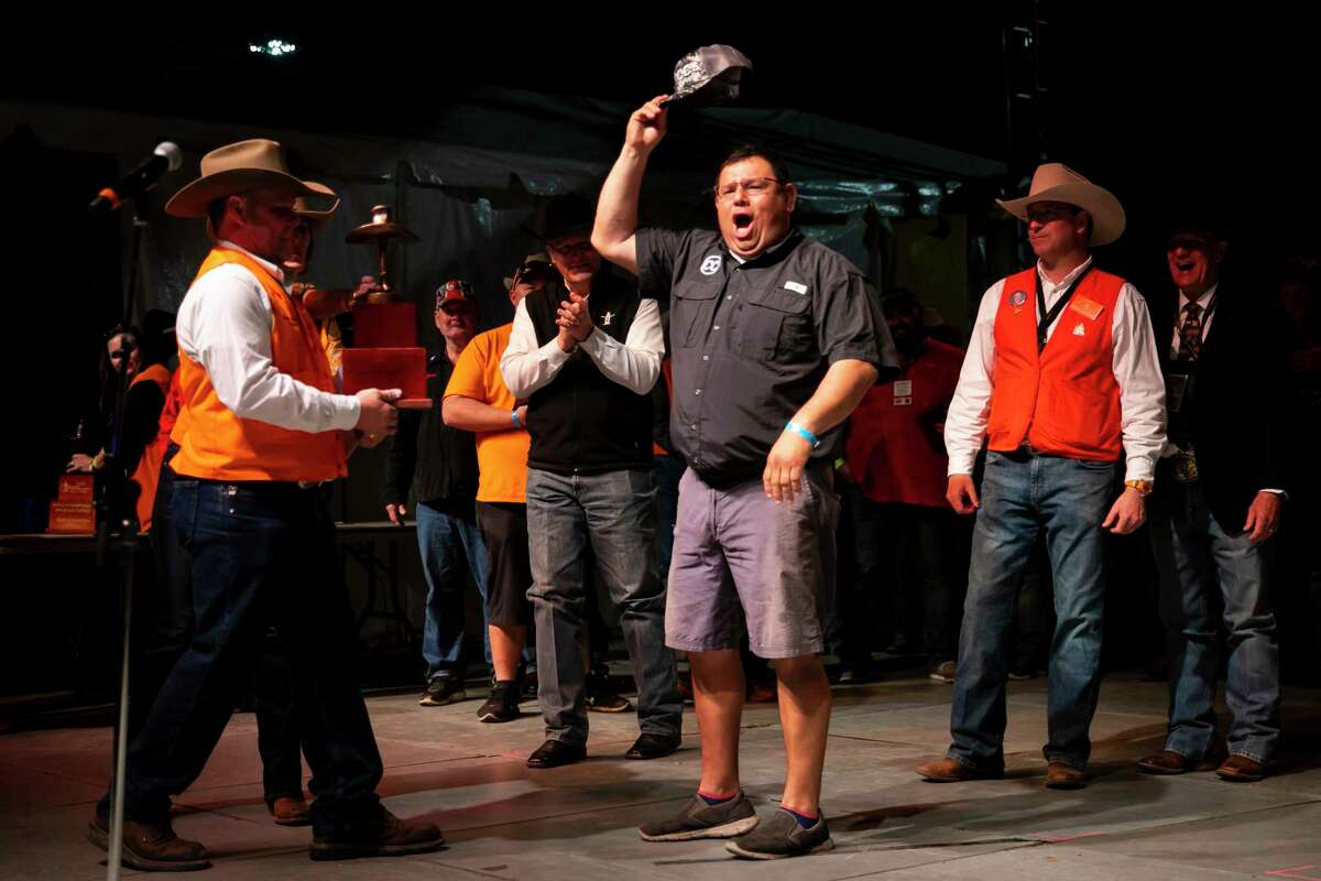 Members of the Fayette County Go Texan team cheer as they are awarded the Go Texan Grand Champion award during the announcement of the winners of the 2020 Houston Livestock Show and Rodeo's World's Championship Bar-B-Que Contest at NRG Park on Saturday, Feb. 29, 2020.