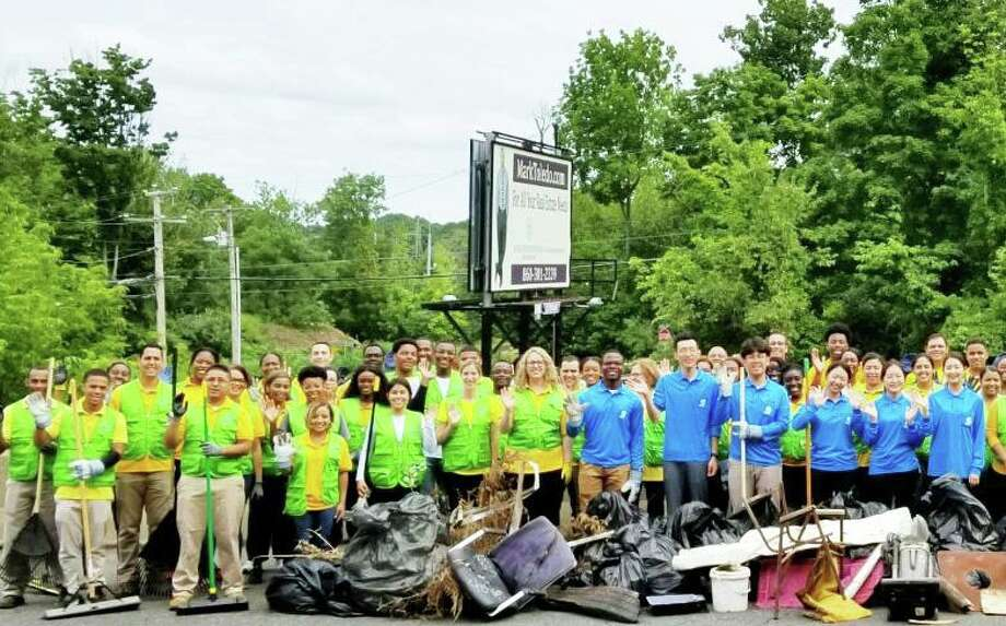 Volunteers from the Church of God held an environmental clean-up on Newfield Street in Middletown in August 2018. Photo: Contributed Photo