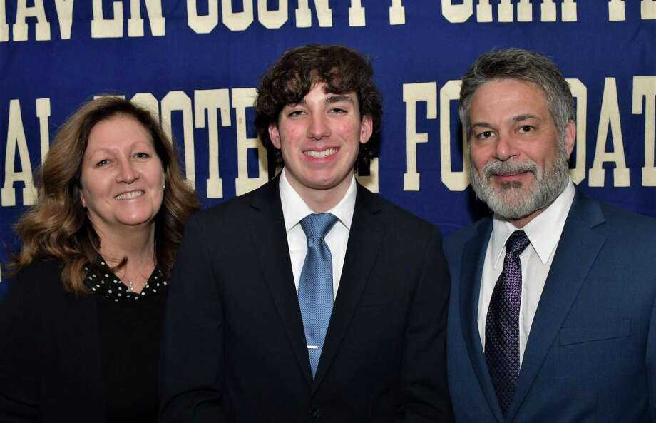 Shelton football player Brian Modica, with parents Karen and Chris, will be honored for academic excellence, leadership and citizenship at the Casey-O'Brien New Haven County Chapter of the National Football Foundation and College Hall of Fame Scholar Athlete awards dinner. Photo: Contributed Photo / Bill O'Brien / Shelton Herald