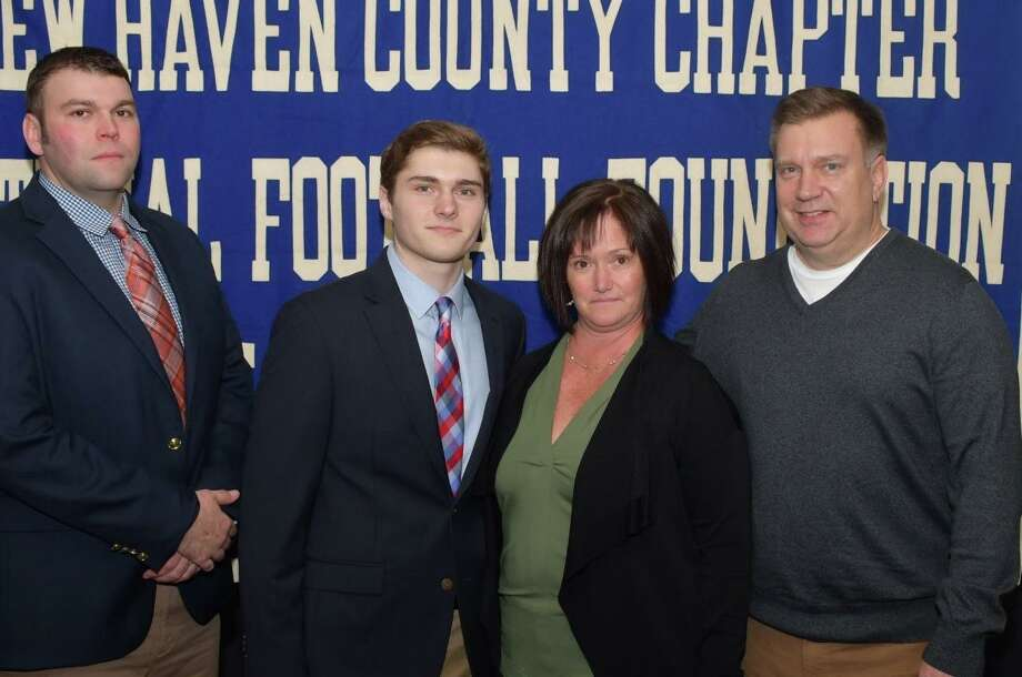 Jonathan Law football player Michael Becker, with coach Chris Haley and parents Stefanie and Walt, will be honored for academic excellence, leadership and citizenship at the Casey-O'Brien New Haven County Chapter of the National Football Foundation and College Hall of Fame Scholar Athlete awards dinner. Photo: Contributed Photo / Bill O'Brien / Milford Mirror