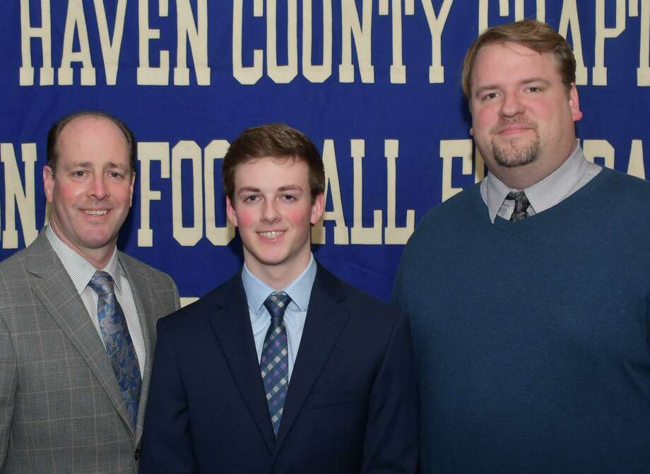 Foran football player Gavin Paul, with his father Daniel and coach Tom Drew, will be honored for academic excellence, leadership and citizenship at the Casey-O'Brien New Haven County Chapter of the National Football Foundation and College Hall of Fame Scholar Athlete awards dinner. Photo: Contributed Photo / Bill O'Brien / Milford Mirror