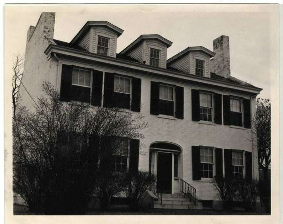 A vintage 1963 picture of the Madison County Historical Museum when it was purchased by the Madison County Historical Society. It is one of nearly 100 structures along and near North Main Street surveyed by architectural historian Michael Allen. The building is currently undergoing reconstruction. Photo: Intelligencer File Photo