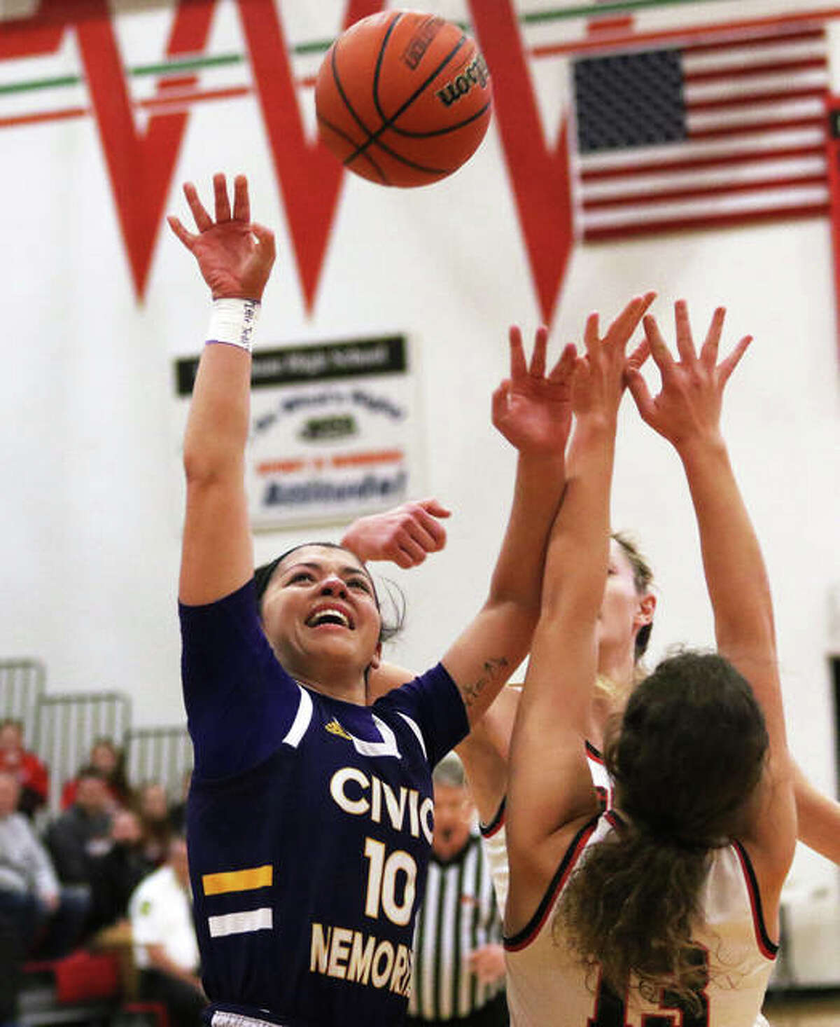 CM's Kourtland Tyus (10) shoots over Highland's Bella LaPorta on Thursday night in the championship game of the Effingham Class 3A Sectional. The defeat ended CM's season at 29-6.