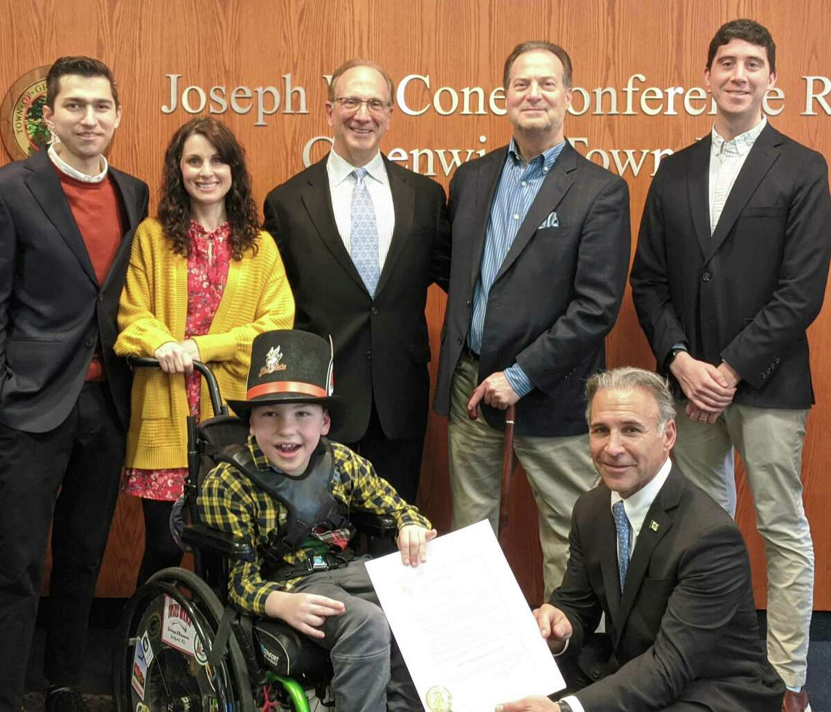 Greenwich marks Rare Disease Awareness Day on Wednesday by shining a light on diseases that are often underfunded in needed research and yet can have devastating results. First Selectman Fred Camillo is joined by Glenville School student Sam Buck, up front, as well as a large group of advocates, including from left, Mark Carles from the Fibrolamellar Cancer Foundation, Allyson Buck from Vanishing White Matters, John Hooper, chair of the Rare Cancer Coalition, Phil Marella, co-founder of the Dana's Angels Research Trust, and Greg Pauletti, co-founder of Tiny Dancer Projects.