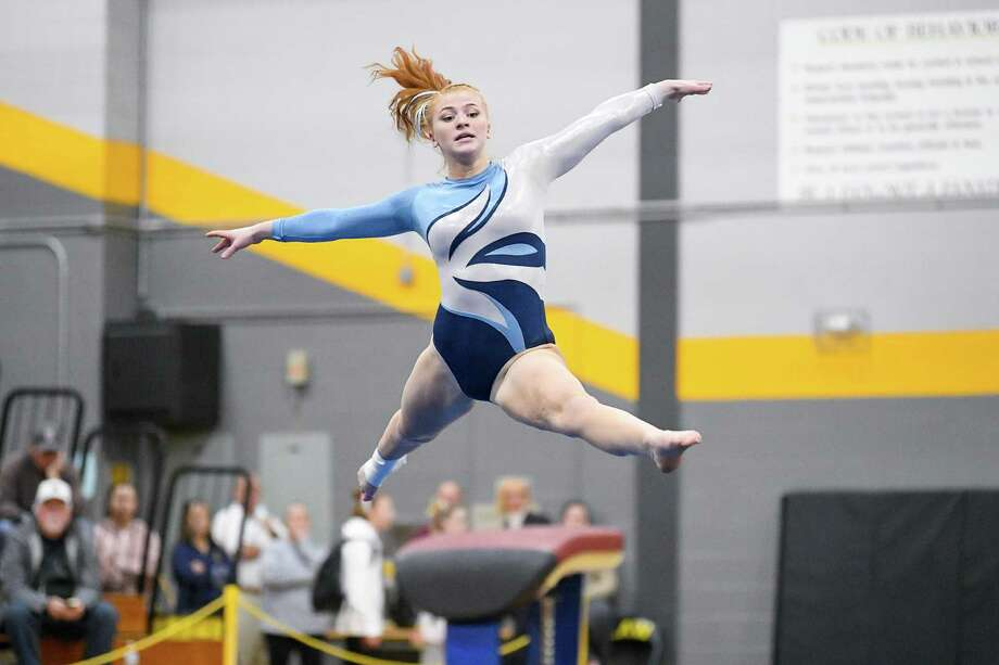 Wilton High's Sarah Collias competes in the floor exercise during the Class M state gymnastics championship Saturday in Milford. Photo: David G Whitham / Copyriqht 2020 David G. Whitham, All rights reserved.