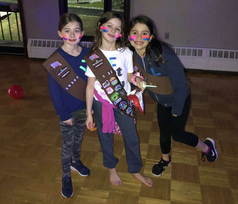 Brownies Chloe Culver, Caroline Collins and Liana Zapata, who are in Girl Scout Troop 50303 at North Street, enjoy the annual K-12 Girl Scout 'Thinking Day' event at the YWCA. This year's theme was Diversity, Inclusion, Equity . Photo: Contributed /