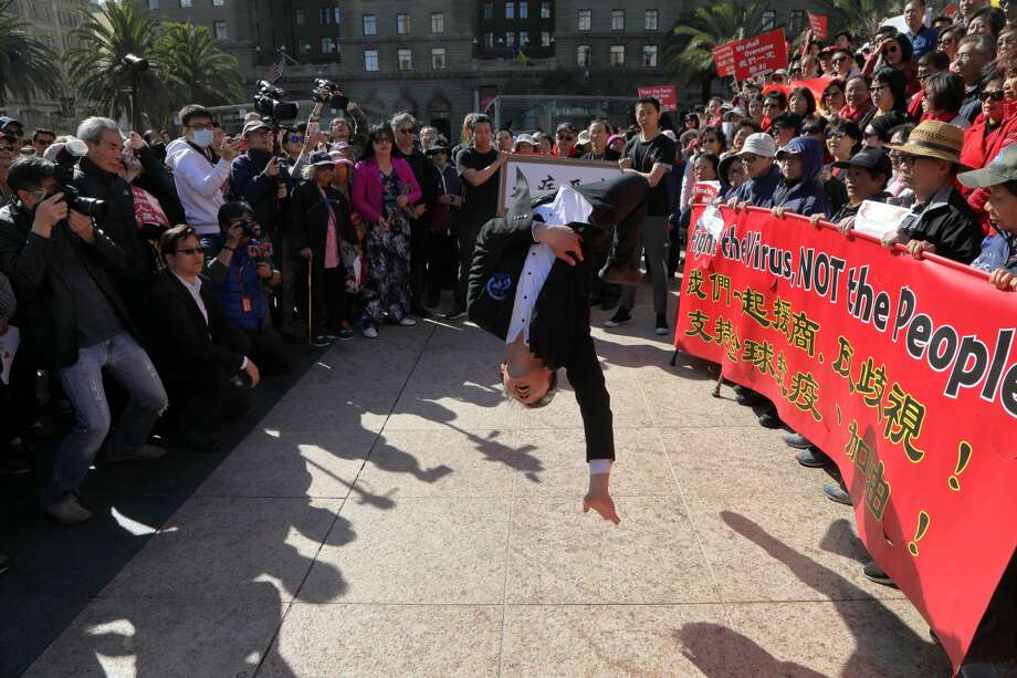 A martial artist completes a series of flips during an anti-discrimination rally in Chinatown on Saturday. Photo: Steven Nelson