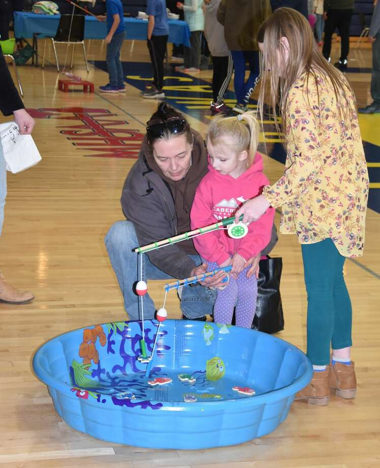 Youth gathered at Manistee High School with their families Saturday for a chance to be active, win prizes and enjoy games during the ATP Carnival. Photo: Arielle Breen/News Advocate