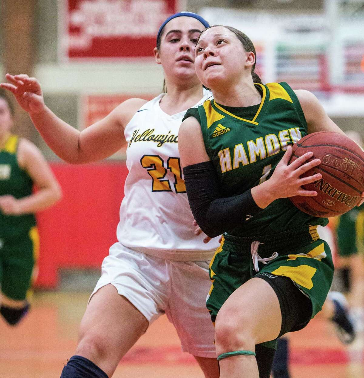 (John Vanacore/for Hearst Connecticut Media) Hamden's Asya Brandon goes up for a layup past East Haven's Isabella Ragaini.