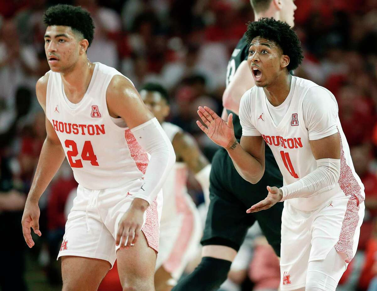 Houston guard Nate Hinton (11) fires up his teammates after a Cougars' basket as guard Quentin Grimes (24) watches during the second half of an NCAA college basketball game against Cincinnati, Sunday, March 1, 2020, in Houston.